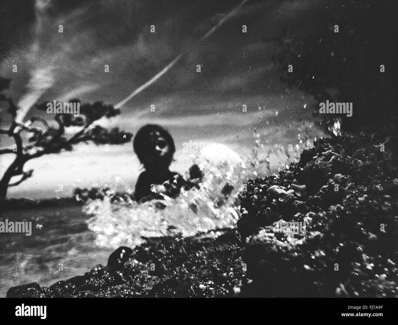 Person Swimming In Sea Against Sky - Stock Image