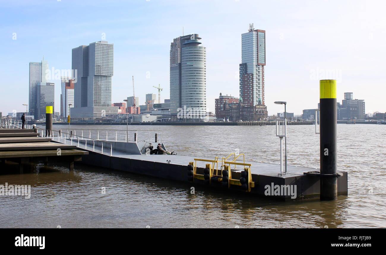 Jetty with Rotterdam skyline. Maastoren (Deloitte HQ), De Rotterdam, World Port center & Montevideo skyscrapers - Stock Image
