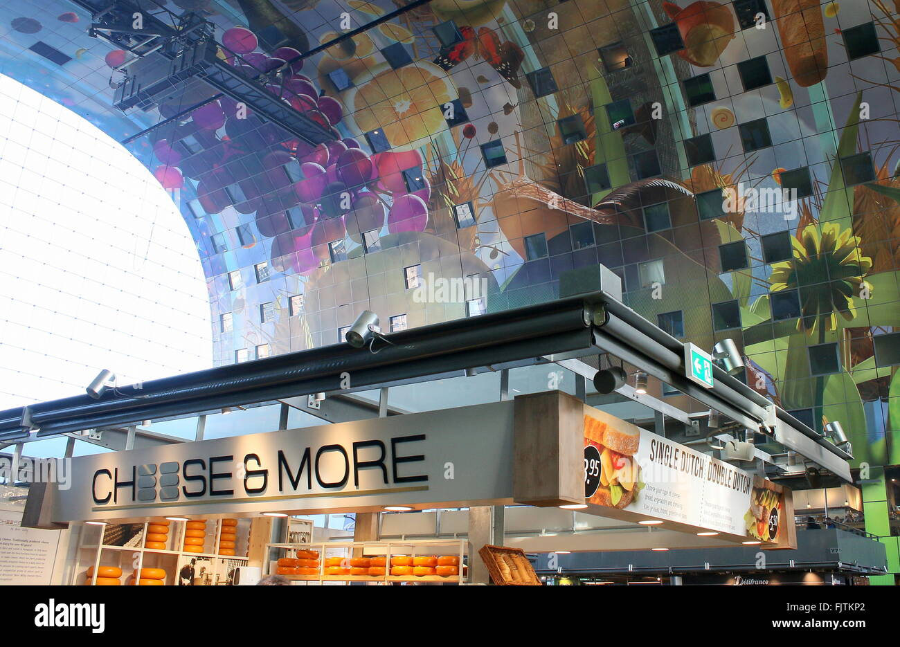 Cheese vendor and colourful artwork on the ceiling of the Rotterdamse Markthal (Rotterdam Market hall), Rotterdam, Stock Photo