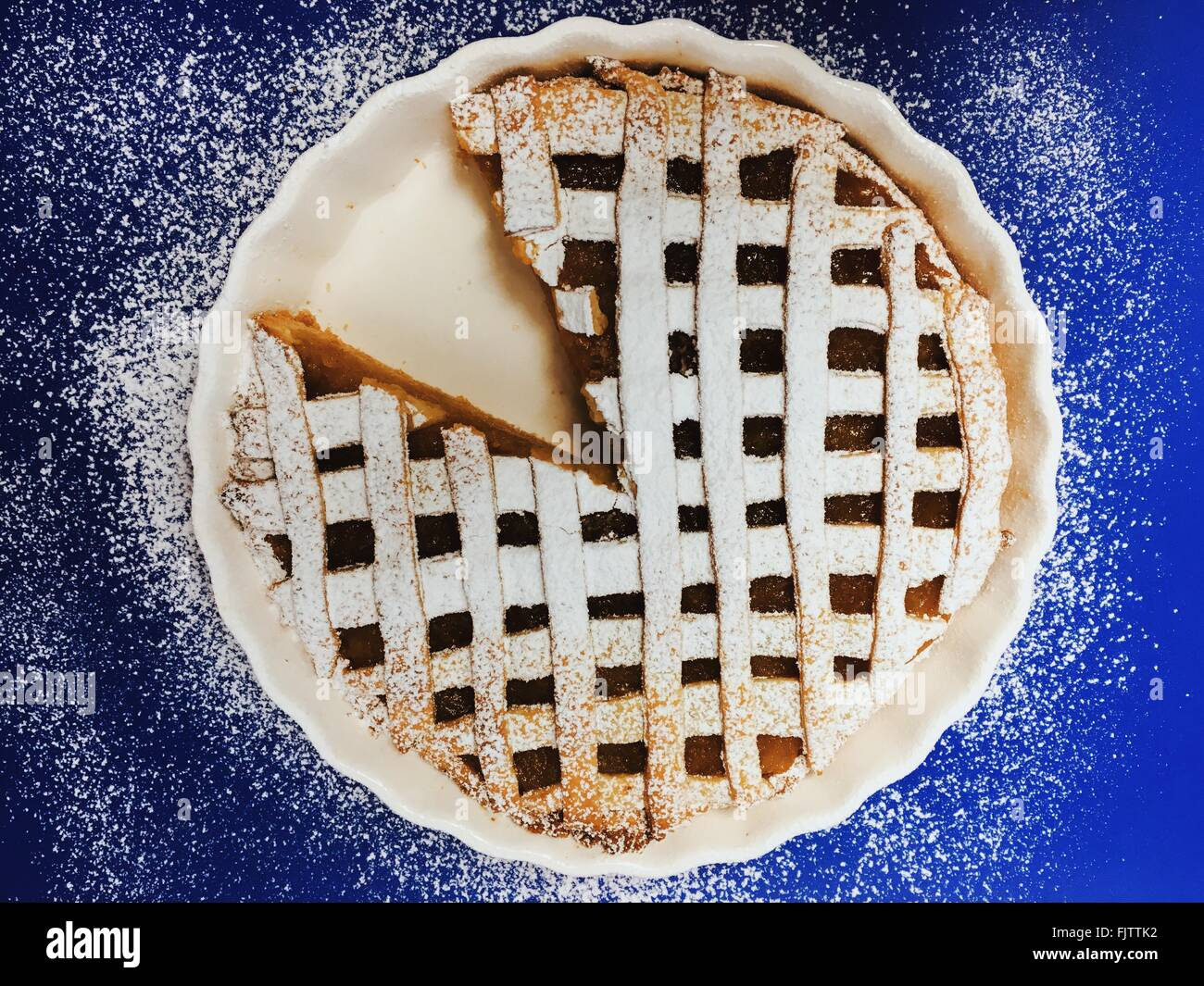 Close-Up Of Sweet Pie With One Slice Removed - Stock Image