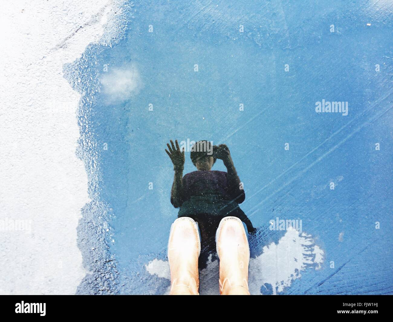 Reflection Of Person In Water - Stock Image