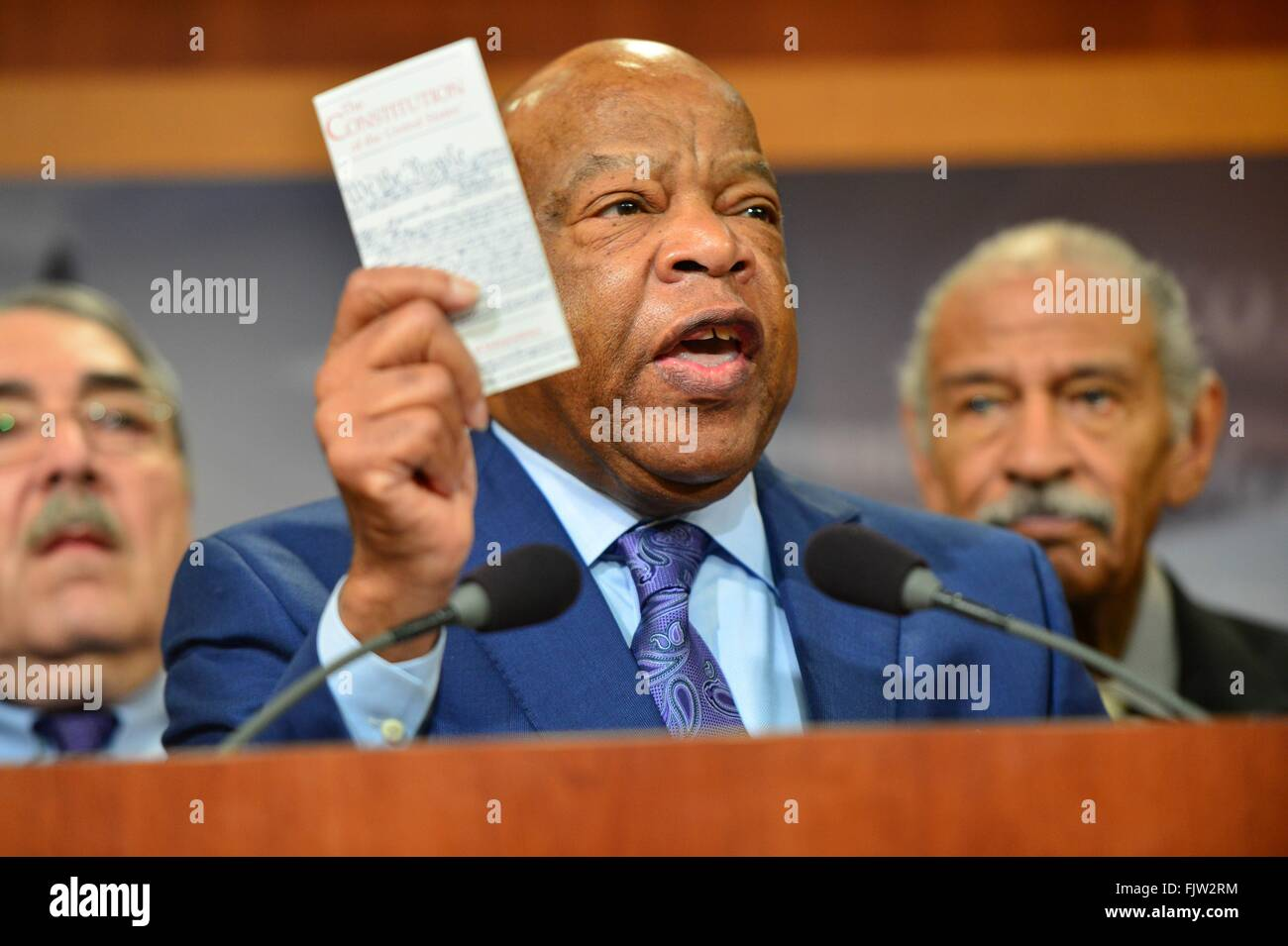 Congressmen and Civil Righs icon, John Lewis holds up a copy of the U.S. Constitution as he joins with Senate Democrats - Stock Image