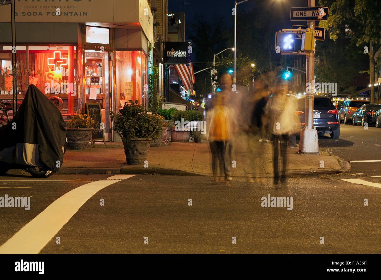 People stroll at night in the Carroll Gardens neighborhood of Stock ...