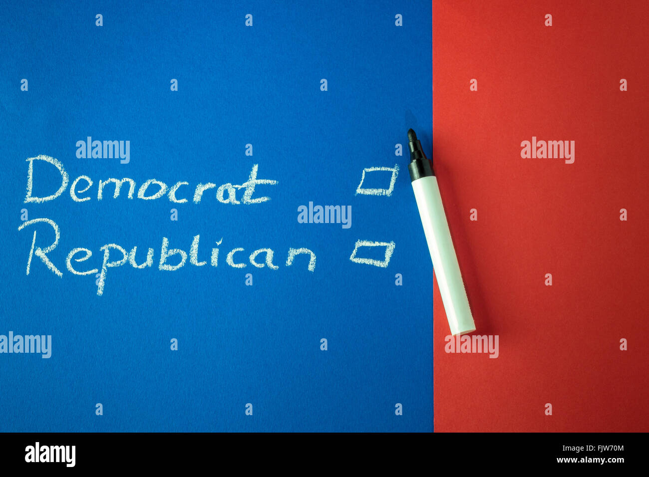 Democrat and Republican and checkboxes written with chalk on red and blue background. Copy space - Stock Image