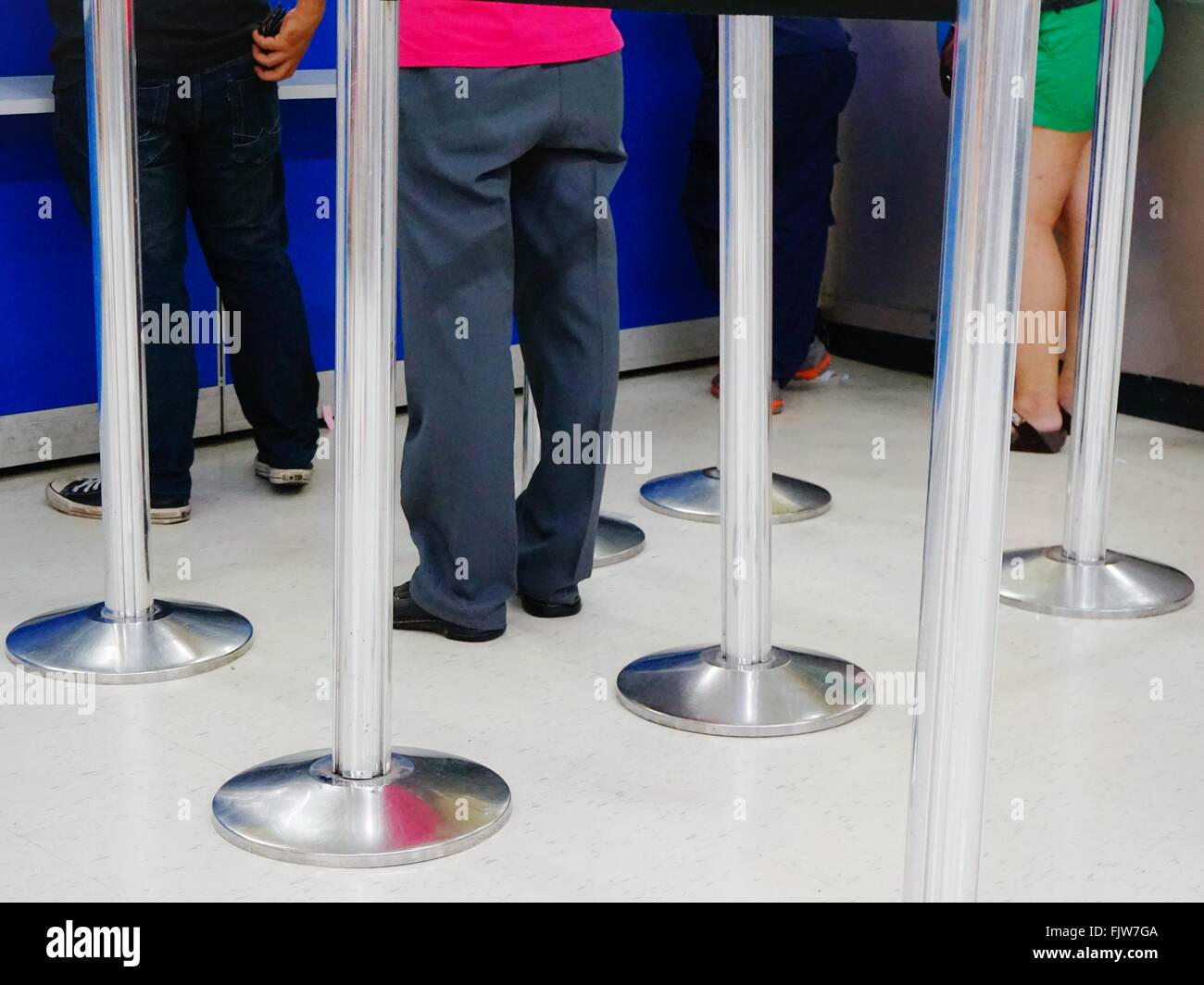 Low Section Of People With Metallic Stands - Stock Image