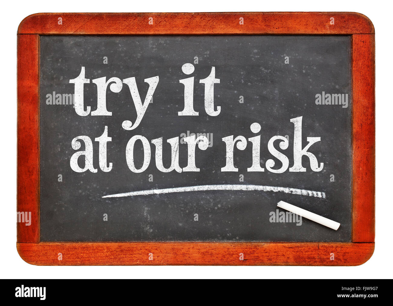 try at out risk marketing slogan - white chalk text on a vintage slate blackboard - Stock Image