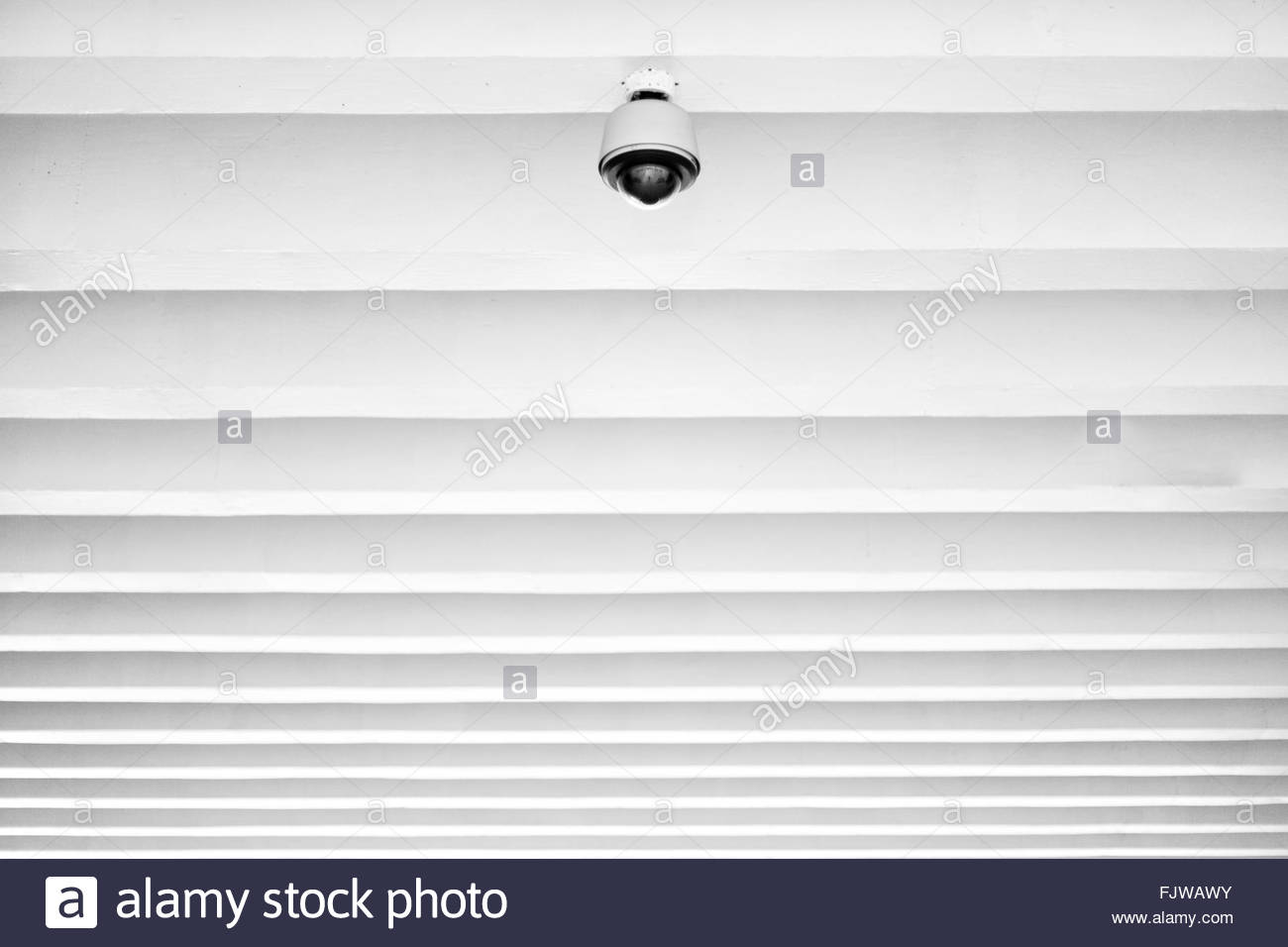 Low Angle View Of Lighting Equipment On Ceiling - Stock Image