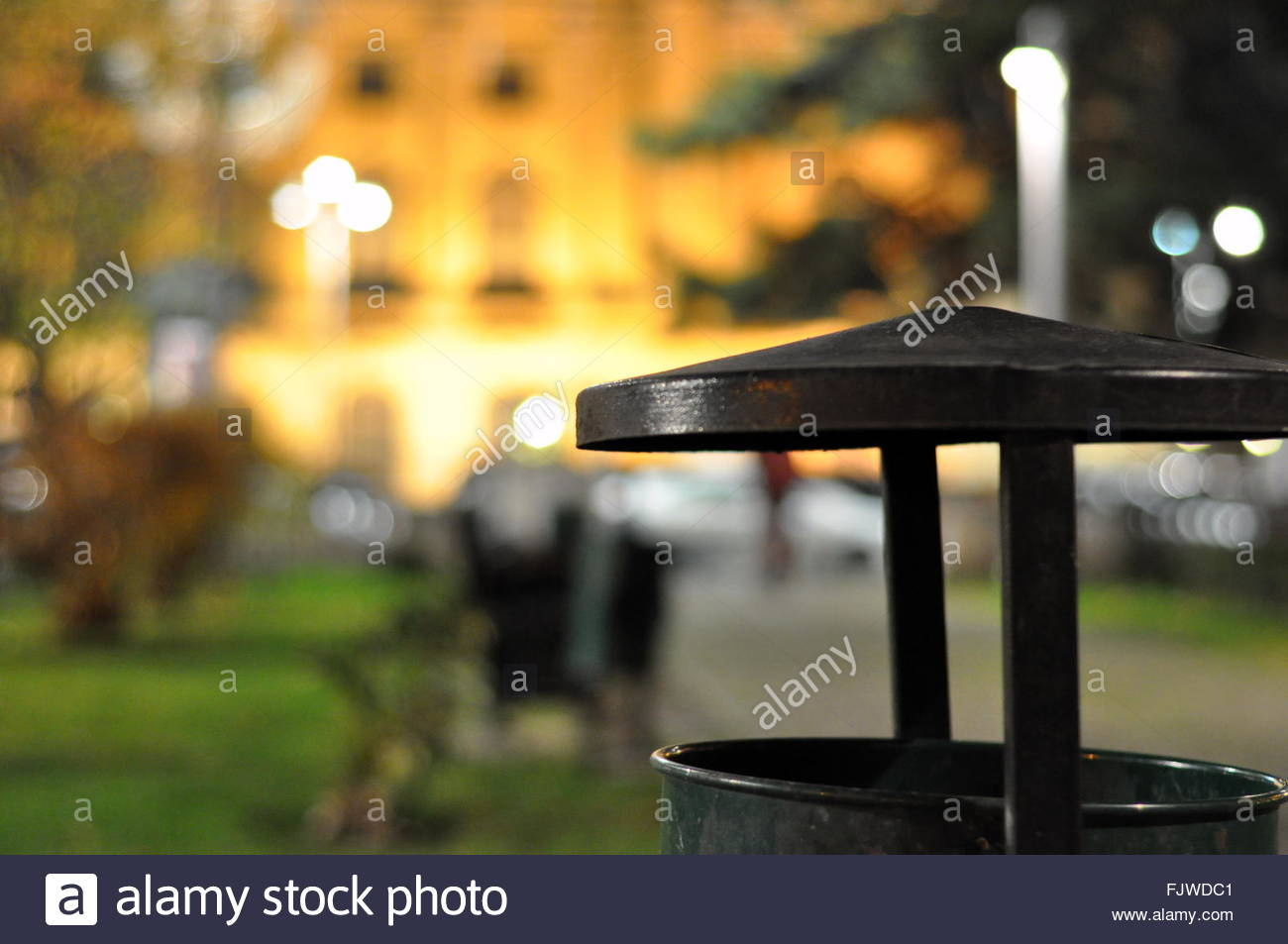 Close-Up Of Metallic Garbage Can In Park - Stock Image