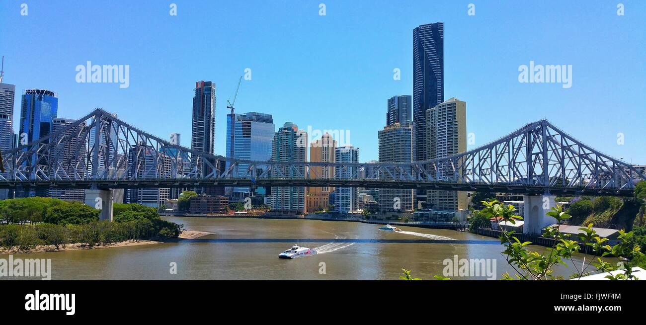 Story Bridge Over Brisbane River In City Against Clear Sky - Stock Image