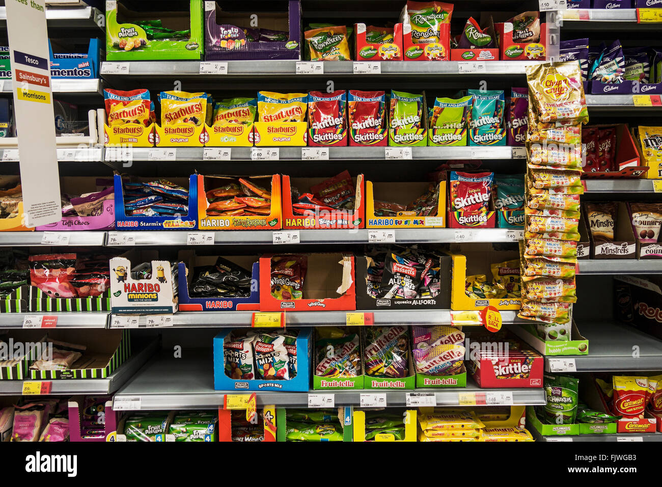 Sweets for sale on display in a supermarket. - Stock Image