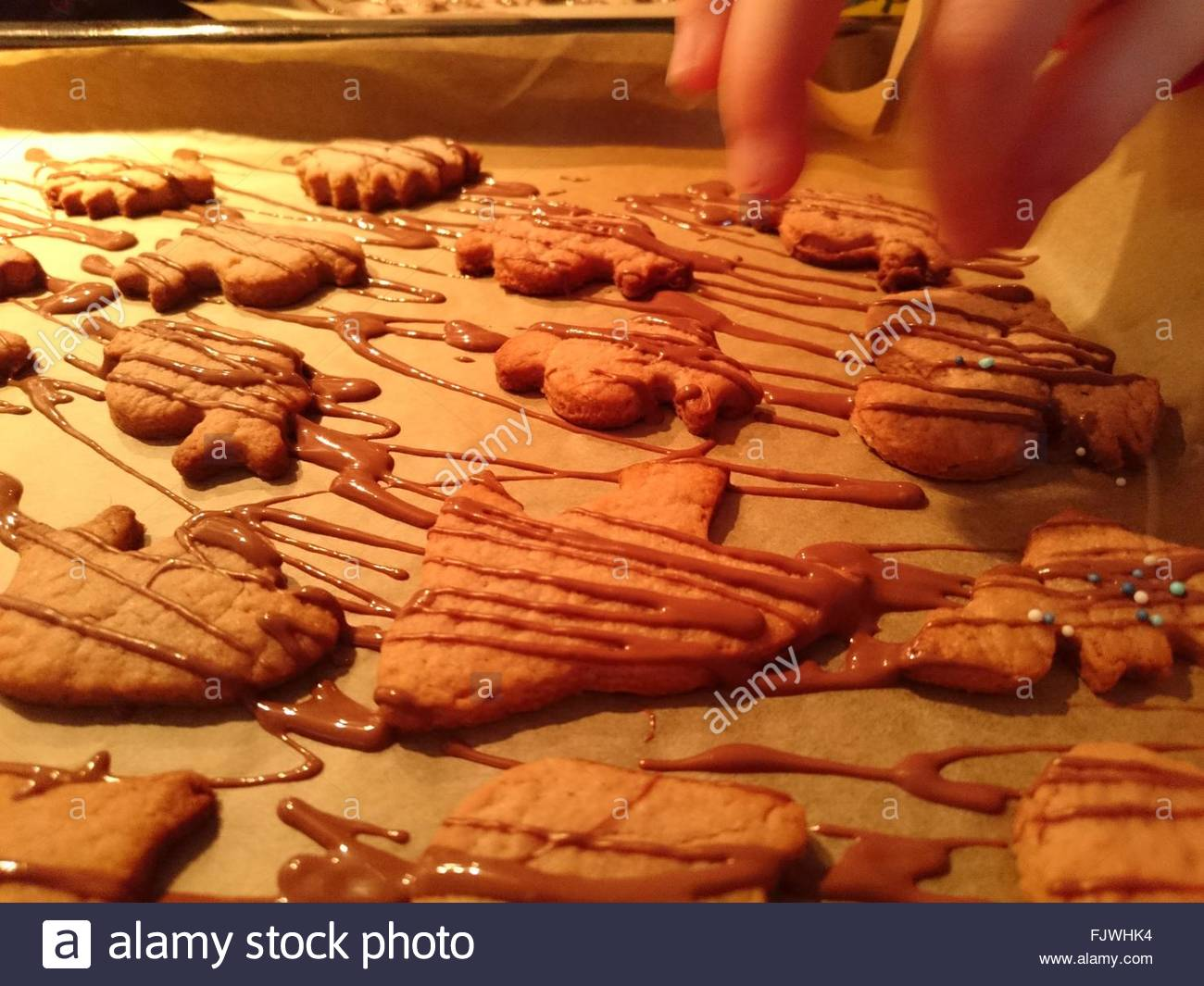 Cropped Image Of Hand Decorating Cookies - Stock Image