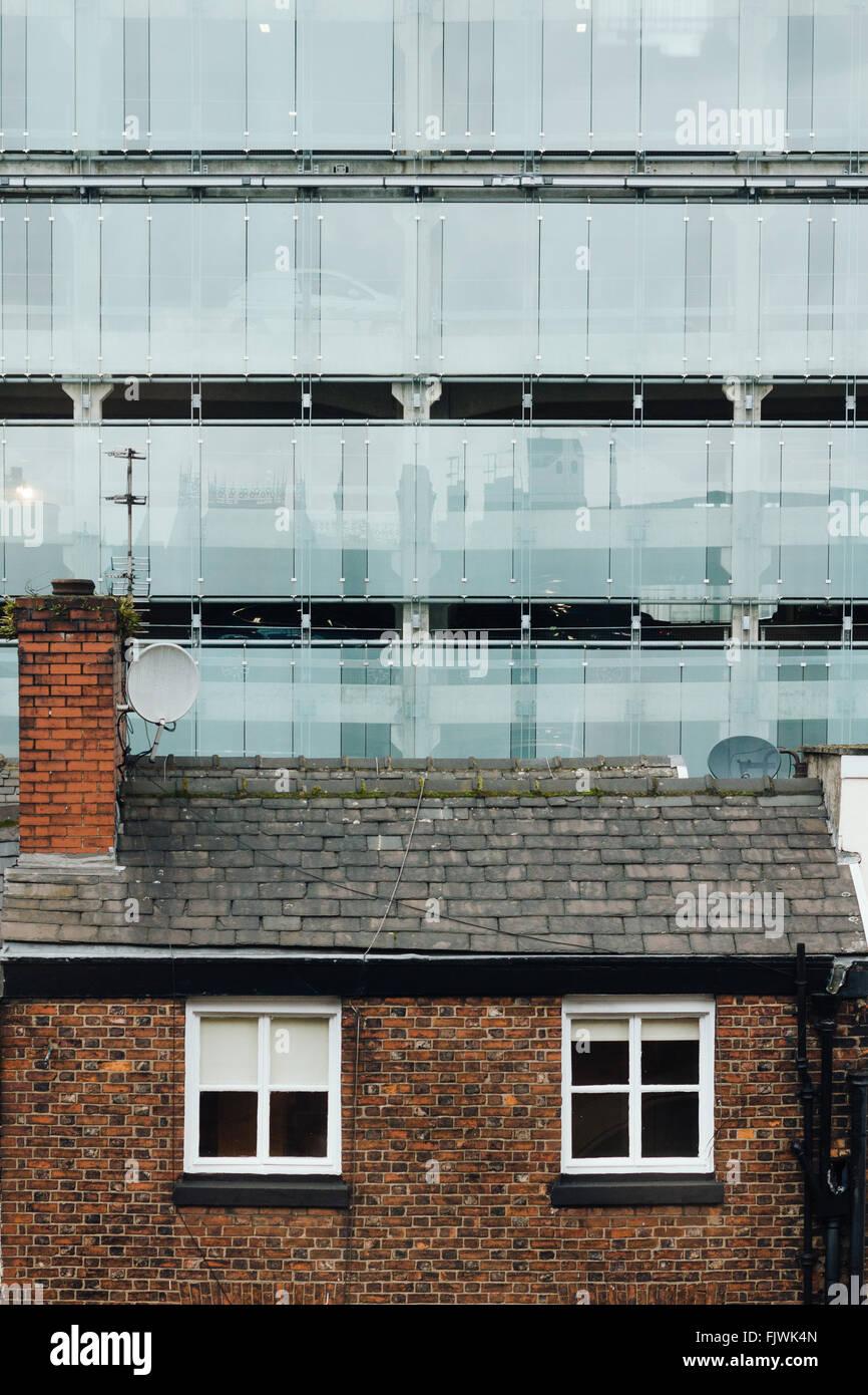 Old house vs new construction. Manchester, Shudehill. - Stock Image