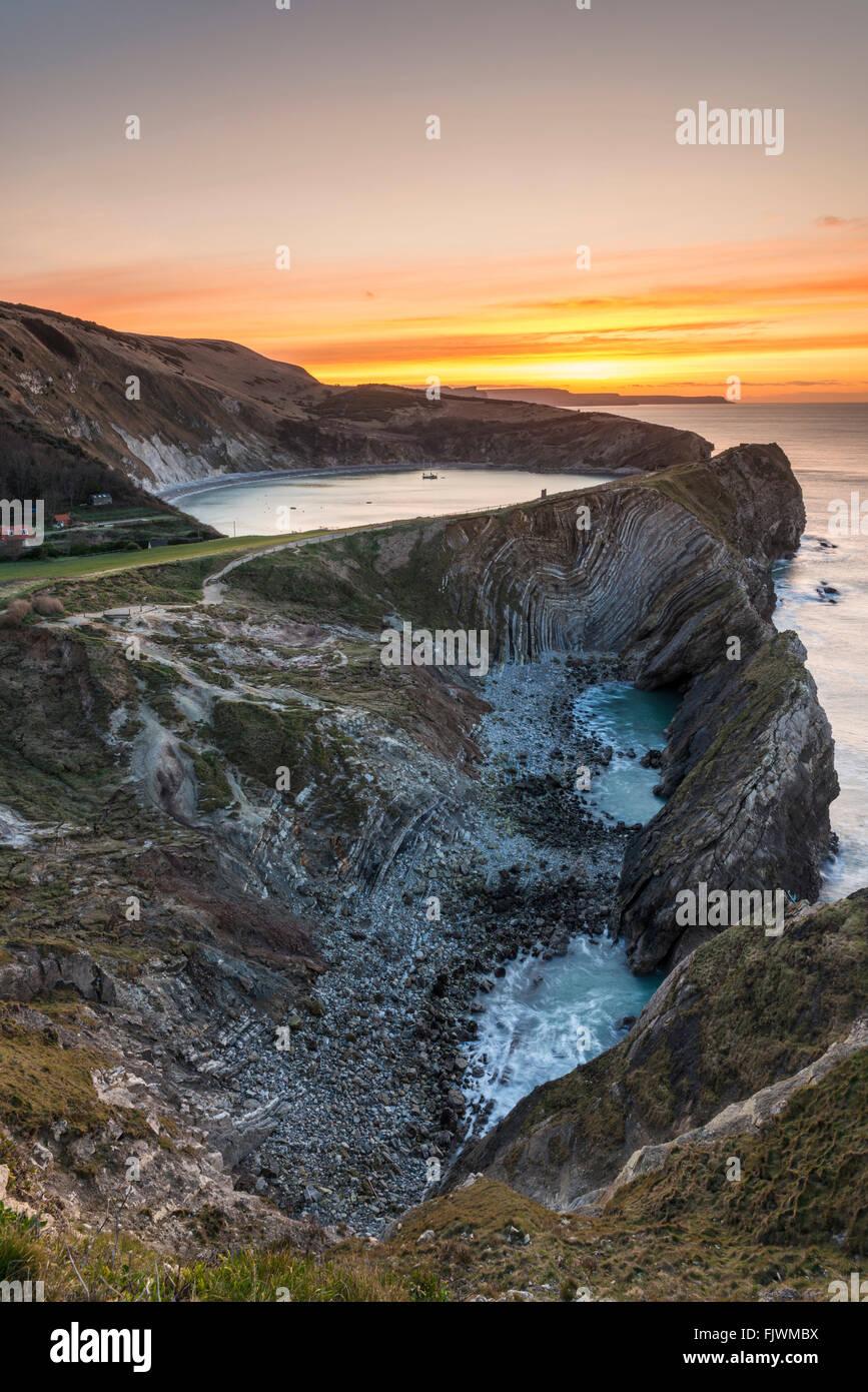 Sunrise over Stair Hole and Lulworth Cove on the Dorset Jurassic Coast, UK - Stock Image