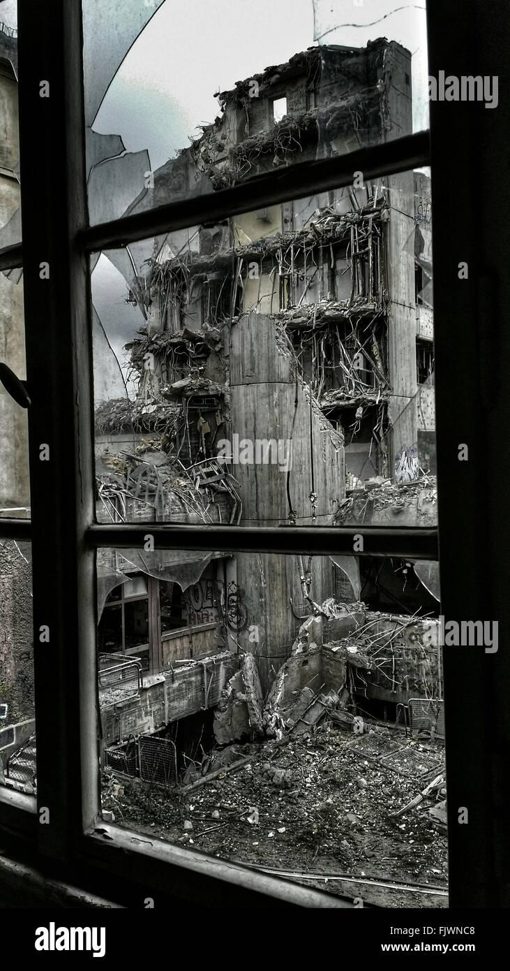 Demolished Building Seen Through Window Glass - Stock Image