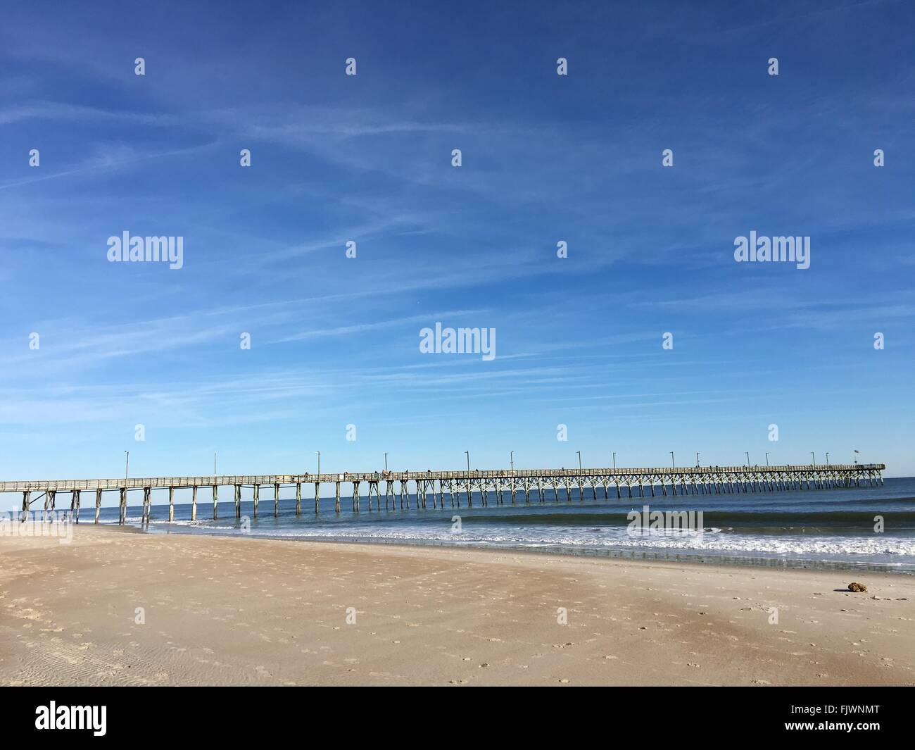 Pier Over Sea Against Sky - Stock Image