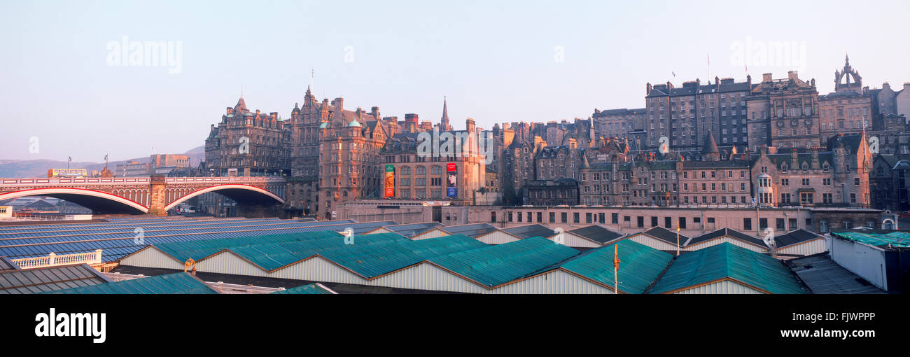 Panoramic view of Edinburgh over Waverley Railway Station along Market Street with North Bridge on left - Stock Image