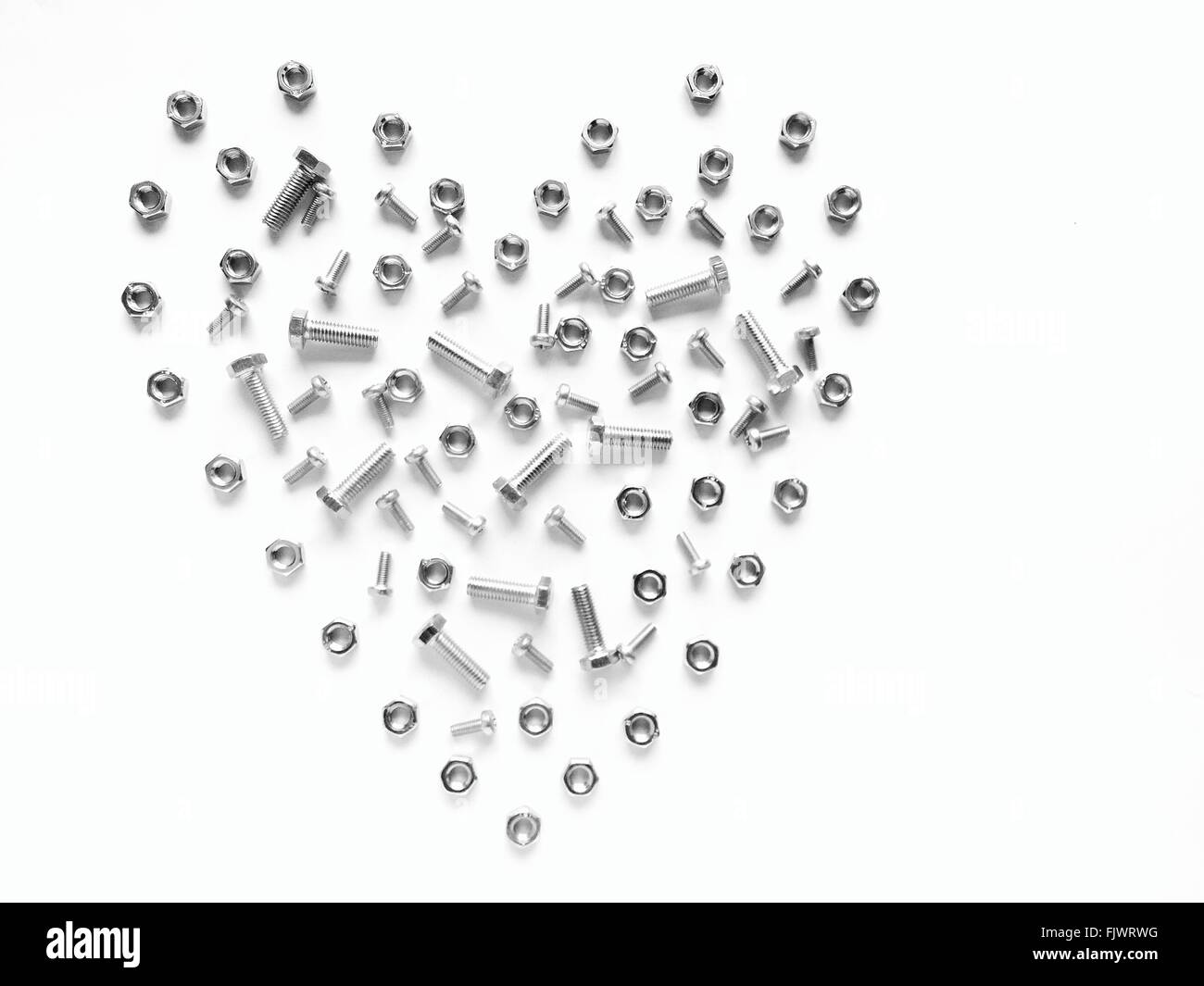 Heart Made Of Nuts And Bolts Against White Background Stock Photo