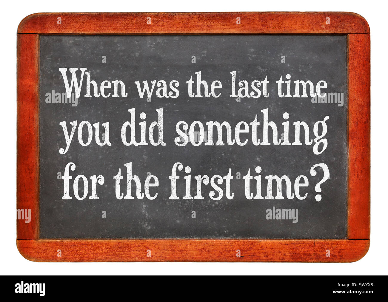 When was last time you did something for the first time? A question on a vintage slate blackboard - Stock Image