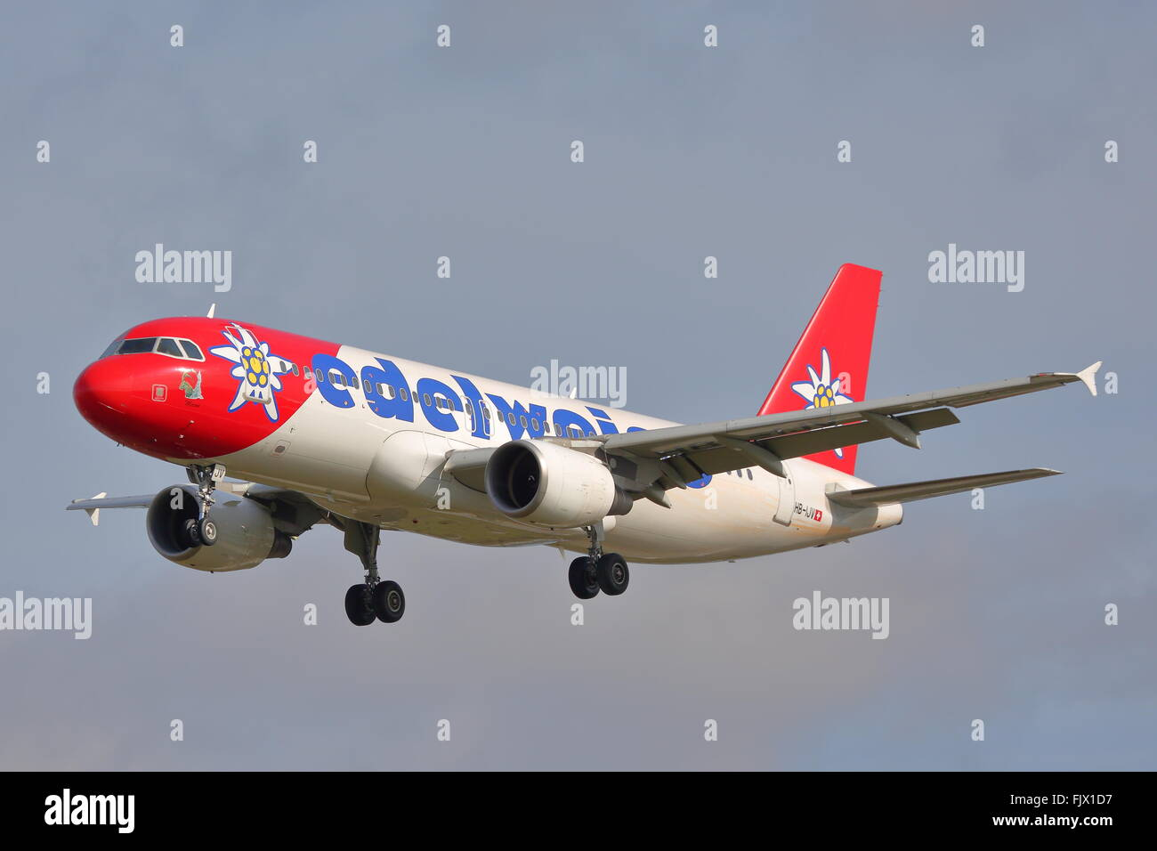Edelweiss Air Airbus A320-200 HB-IJV landing at Heathrow - Stock Image