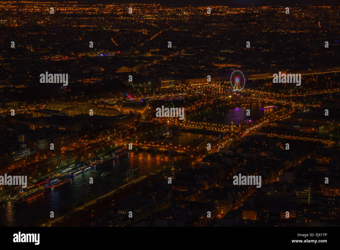 High Angle View Of Illuminated Cityscape Seen From Eiffel Tower - Stock Image