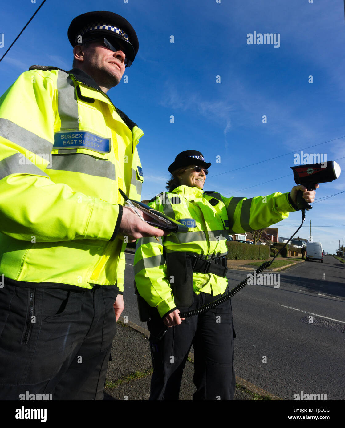 British Police officers carrying out speed checks - Stock Image