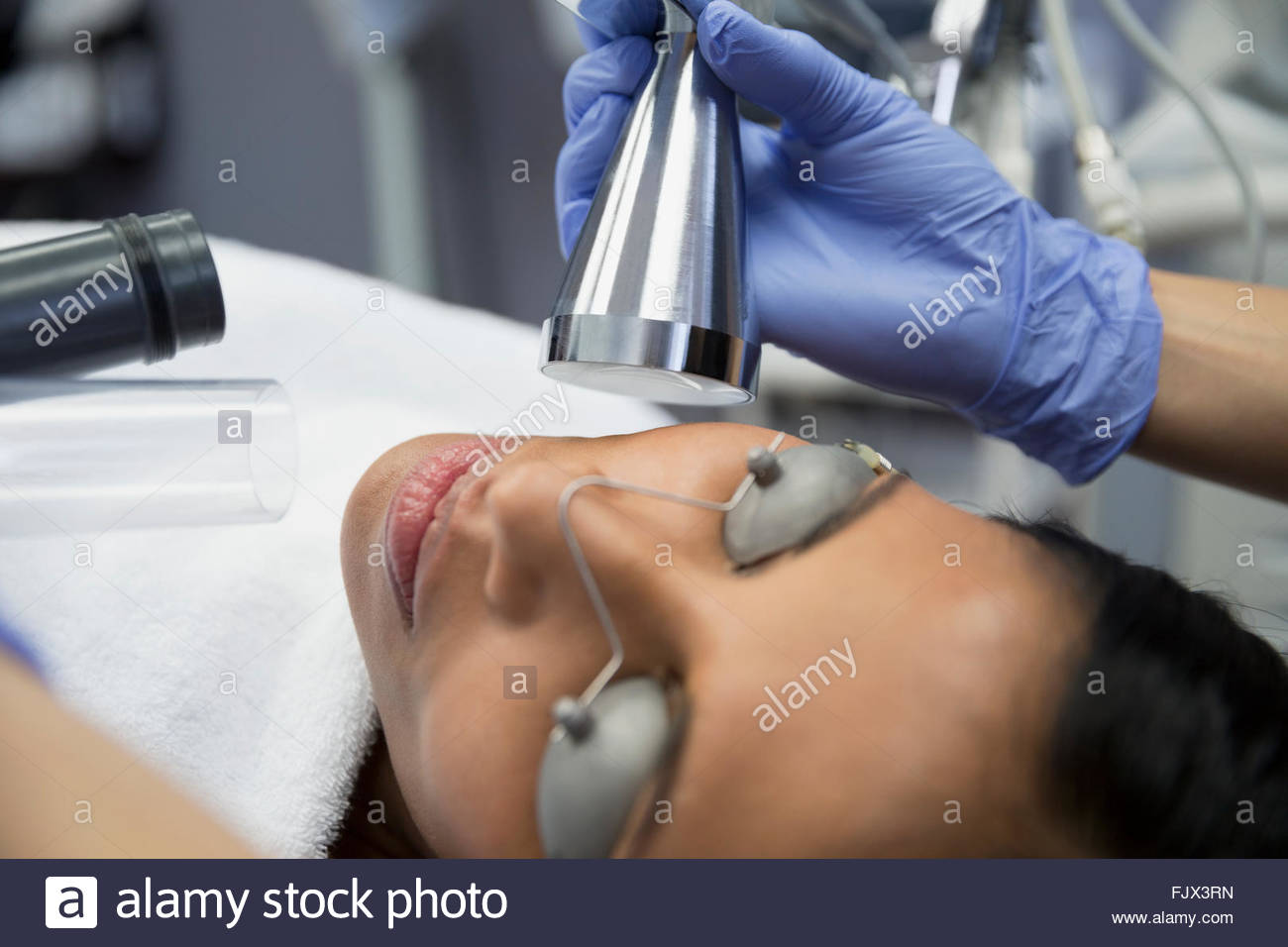 Woman receiving facial treatment - Stock Image