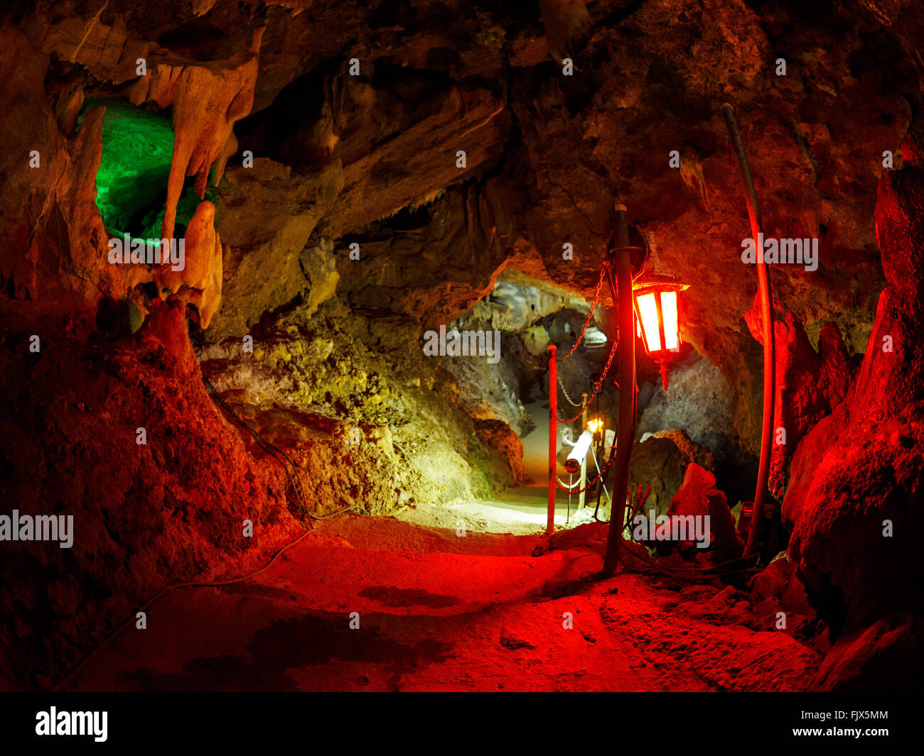 Illuminated Lantern In Cave - Stock Image