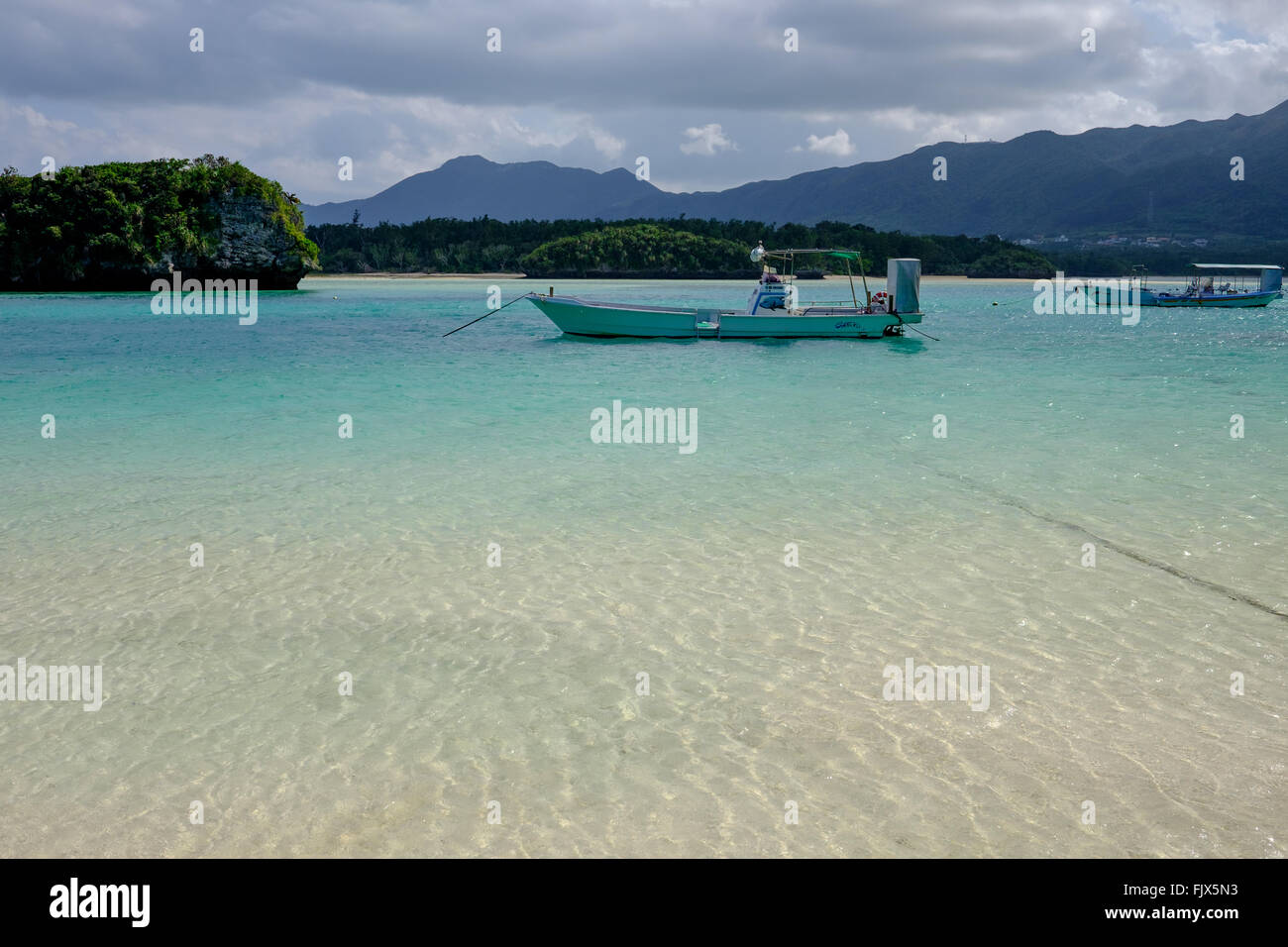 Boats Moored On Sea At Ishigaki - Stock Image