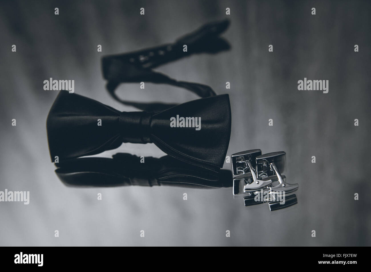 High Angle View Of Bow Tie And Cuff Link On Table - Stock Image