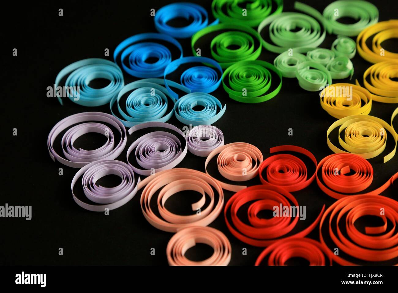 High Angle View Of Colorful Ribbon On Black Background - Stock Image