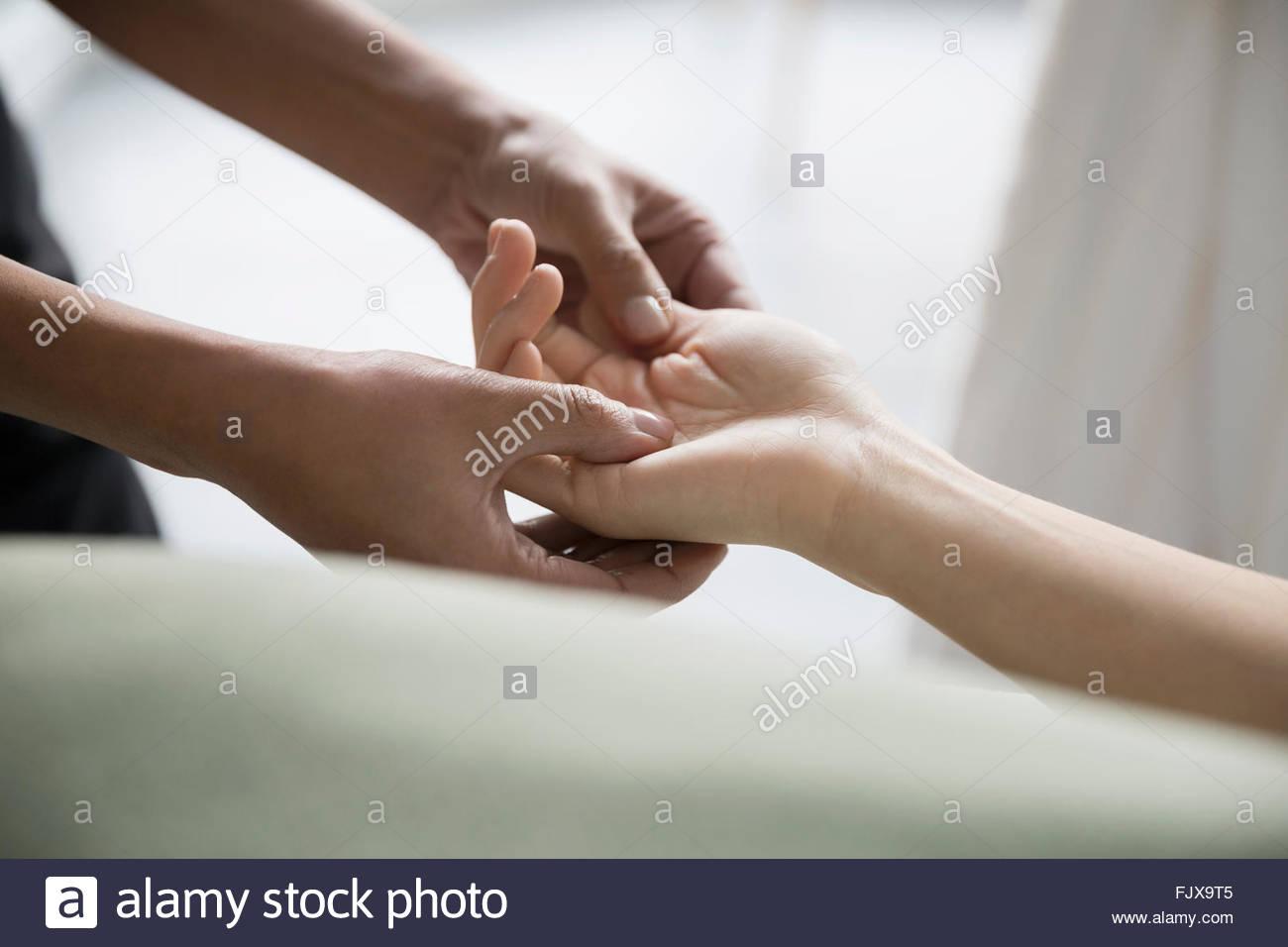 Woman receiving hand massage - Stock Image