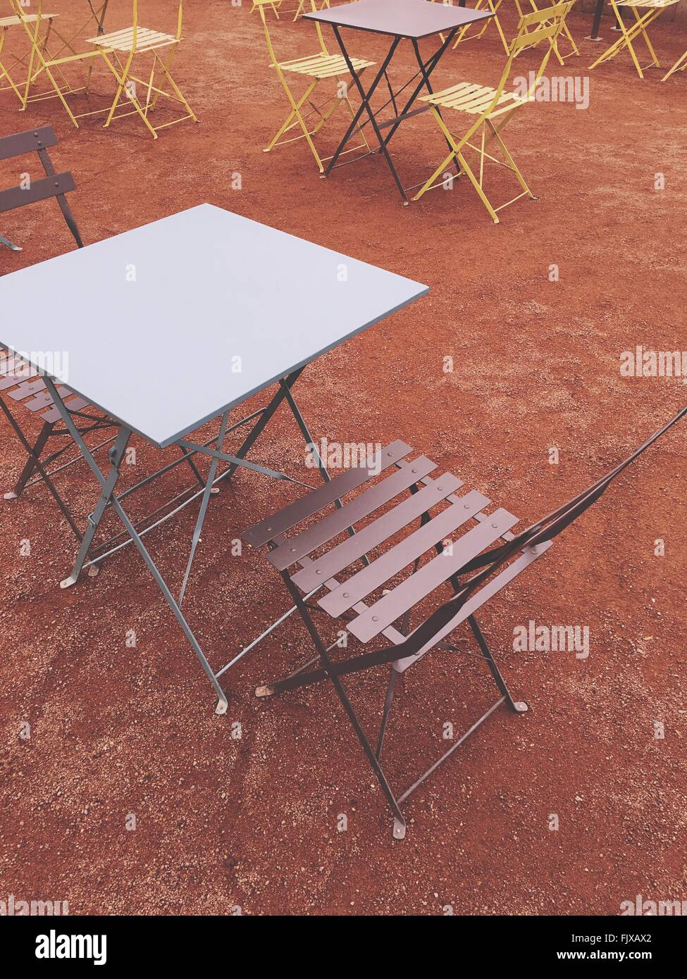 High Angle View Of Empty Chairs And Tables At Sidewalk Cafe - Stock Image