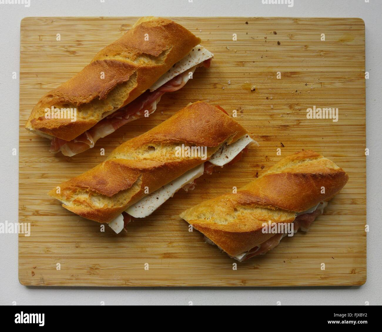High Angle View Of Sandwiches On Cutting Board - Stock Image