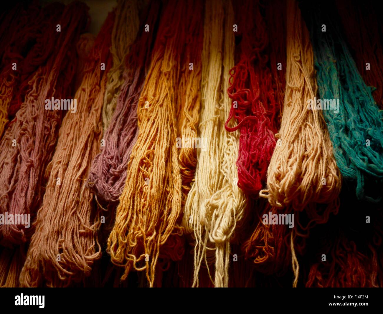 Close-Up Of Multi Colored Wool Hanging At Store Stock Photo