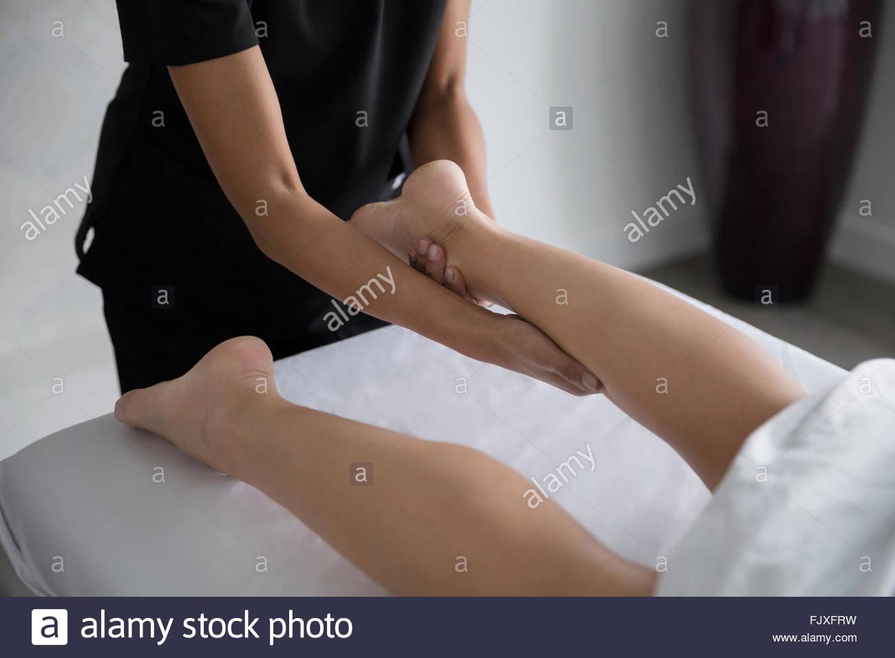 Woman receiving leg massage - Stock Image