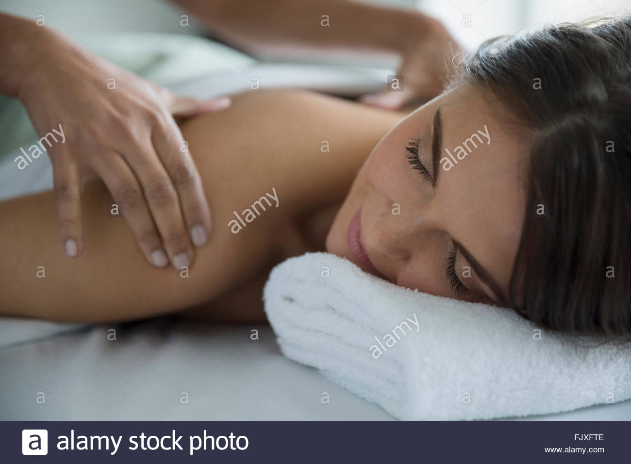 Woman receiving back massage - Stock Image