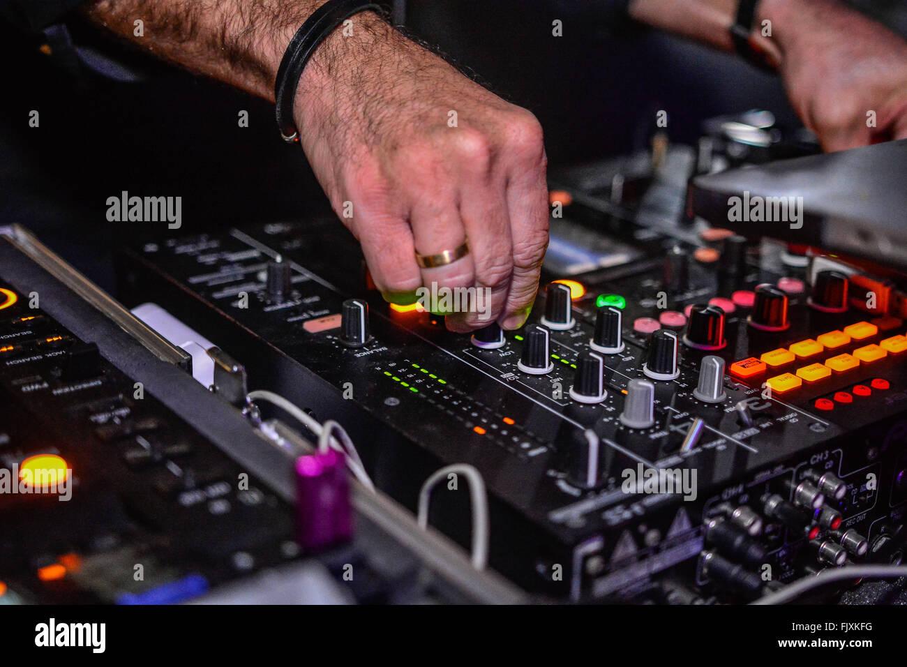 Hands Adjusting Regulators Of A Mixer Unit Stock Photo