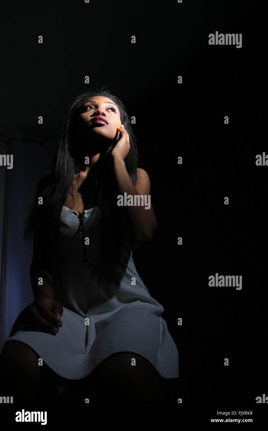 Front View Of Fashion Model Against Black Background - Stock Image