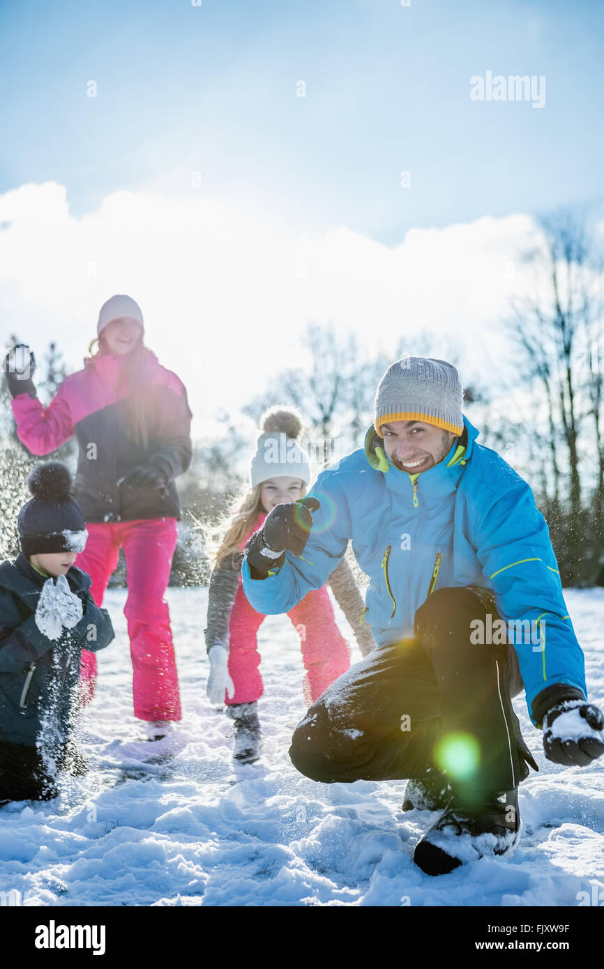 Family playing snowball fight - Stock Image