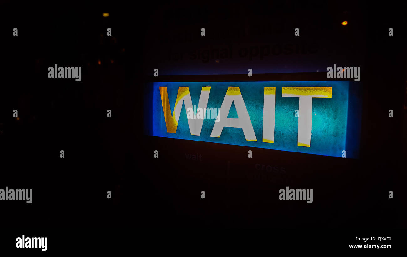 Close-Up Of Illuminated Wait Sign - Stock Image