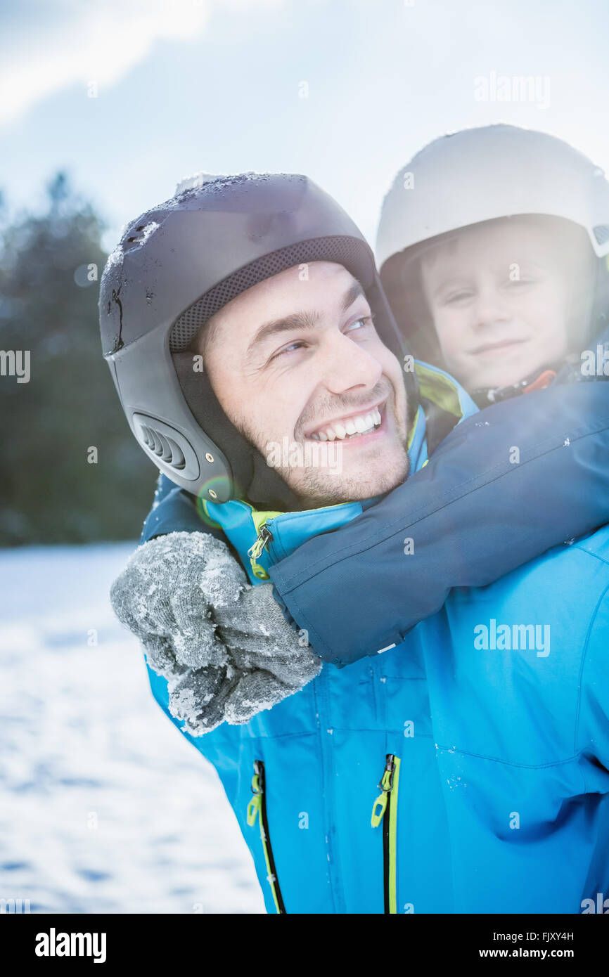 Piggyback with father and son - Stock Image