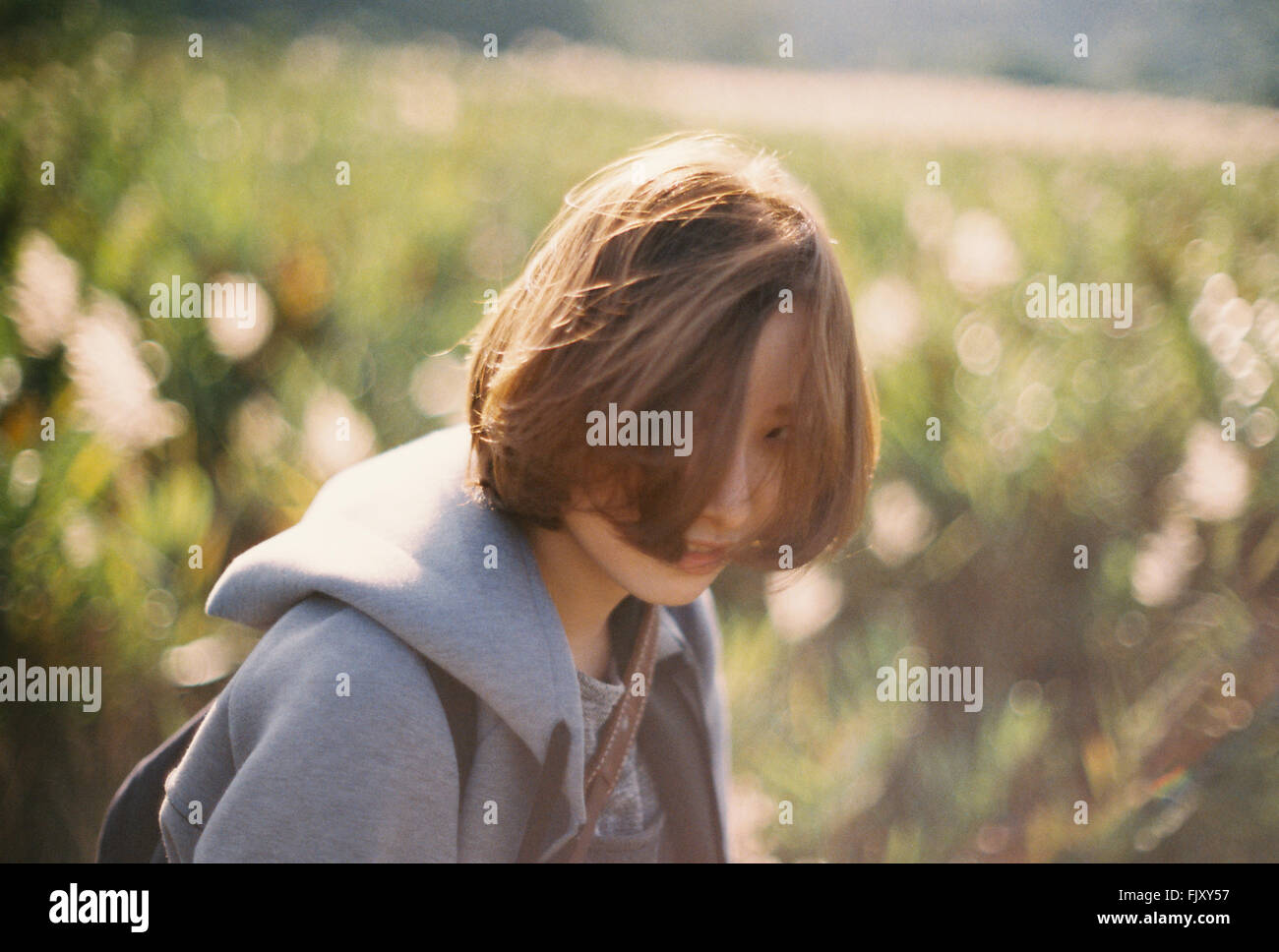 Portrait Of Young Woman On Field - Stock Image