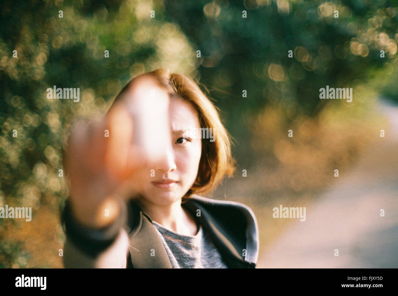 Close-Up Of Young Woman With Arm Raised - Stock Image