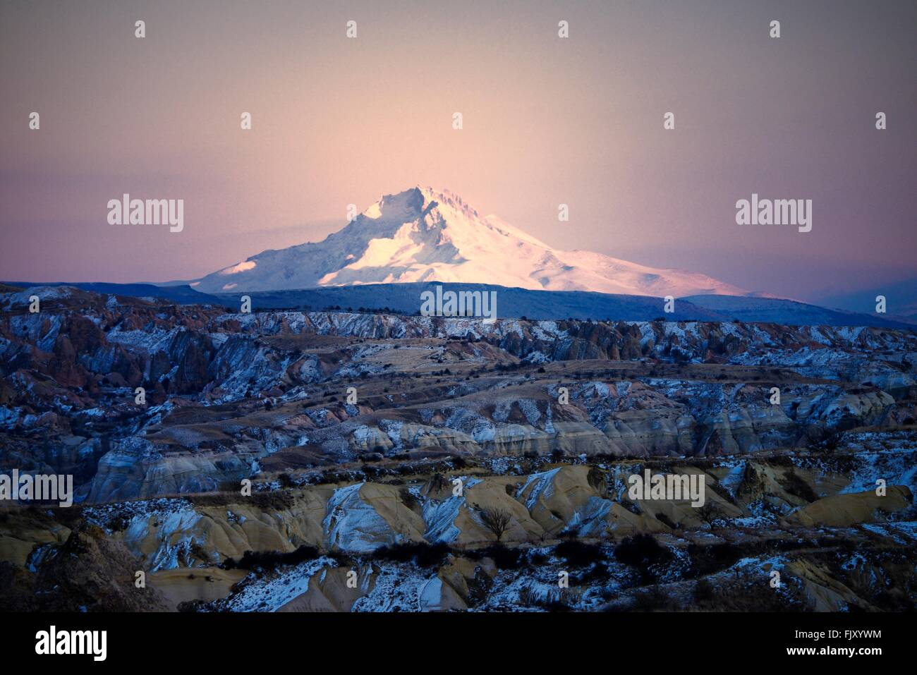 Snow covered volcanic 3916m peak of Mount Erciyes, highest mountain in central Anatolia Turkey. S.E. over gorges - Stock Image
