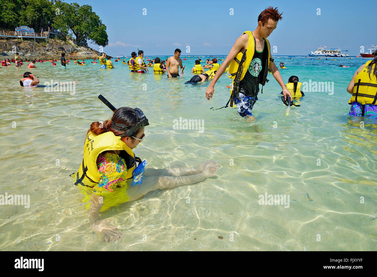 Pulau Pinang, a small island next to Pulau Redang, is a popular snorkeling spot for Chinese tourist groups. - Stock Image