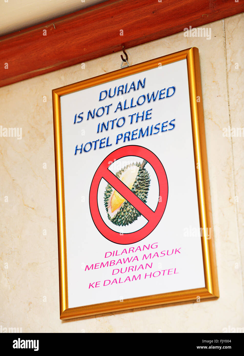 Warning sign prohibits guests to take smelly durian fruit into the hotel premises. - Stock Image