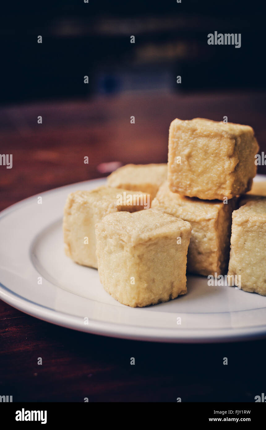 delicious fried Tofu and fish, Vintage color filter - Stock Image