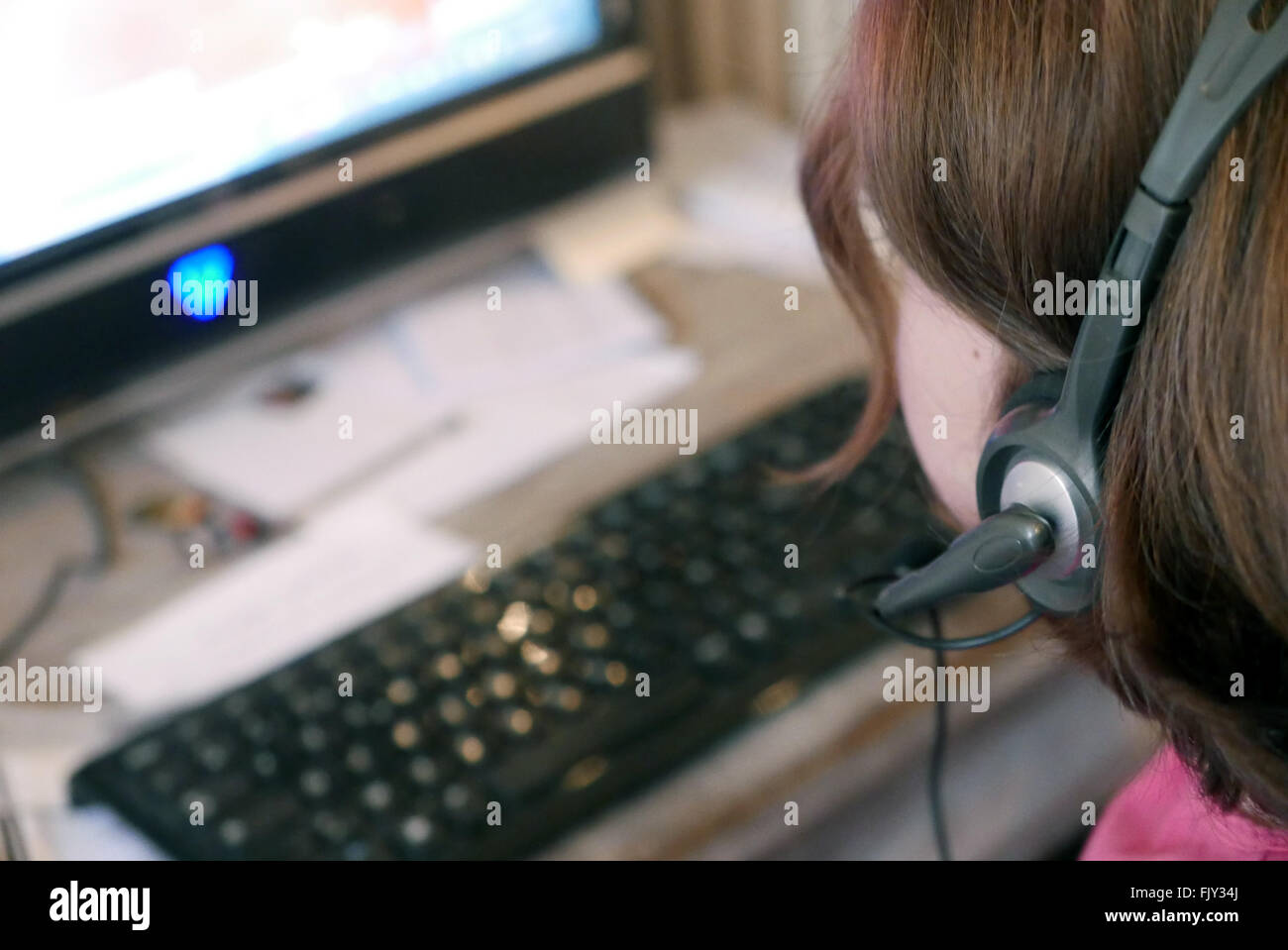 Woman Wearing Headset And Using Computer - Stock Image