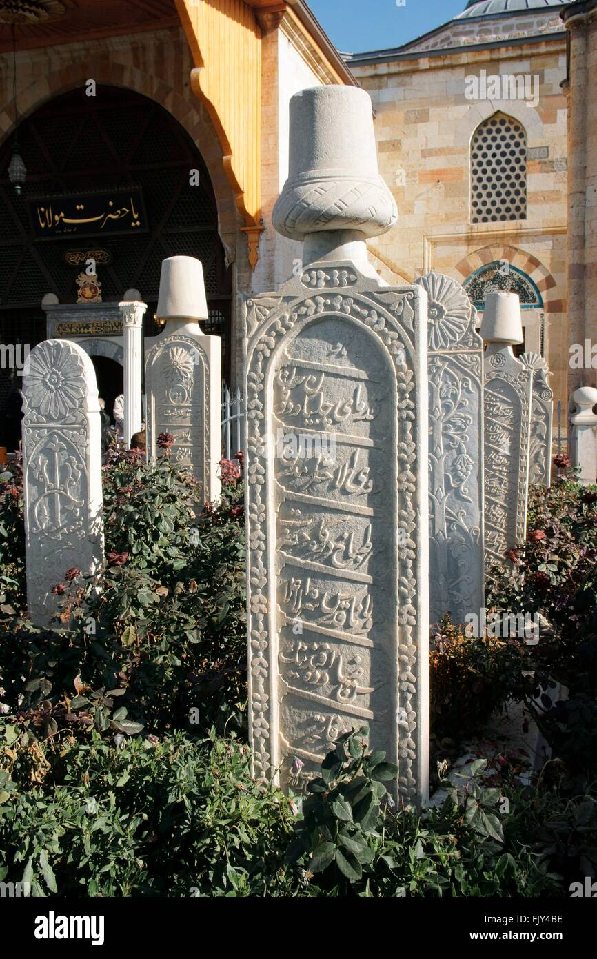 Mevlana Museum, city of Konya, Turkey. Ornate white grave slabs mark the Sufi reed flute and ney players whirling - Stock Image