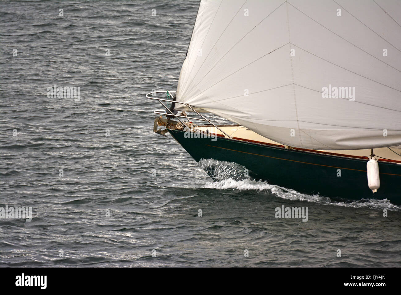 Sail boat cut the water - Stock Image